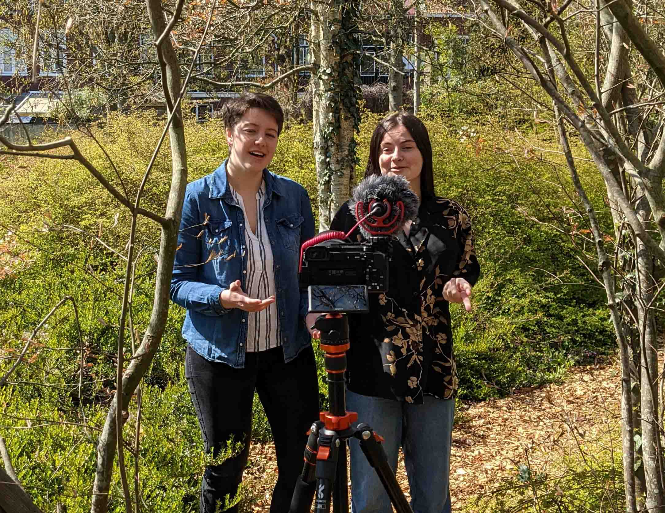 Two scientists filming a video