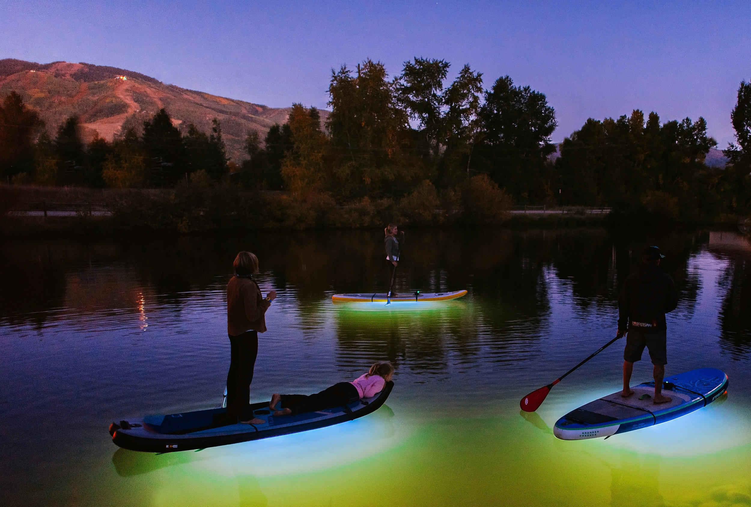 Paddleboards with Glow Lights on Fetchers Pond