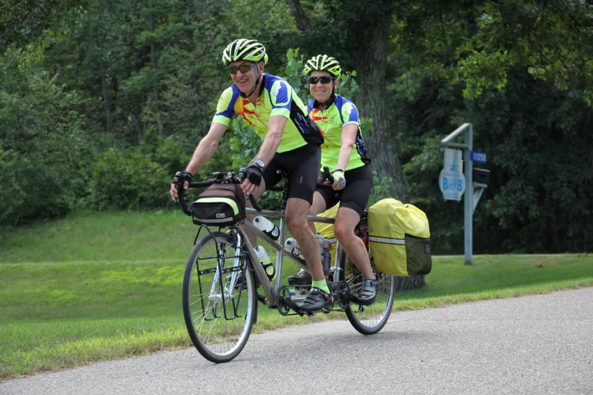 Couple bicycling on the tandem bike at Leech Lake Resort B&B