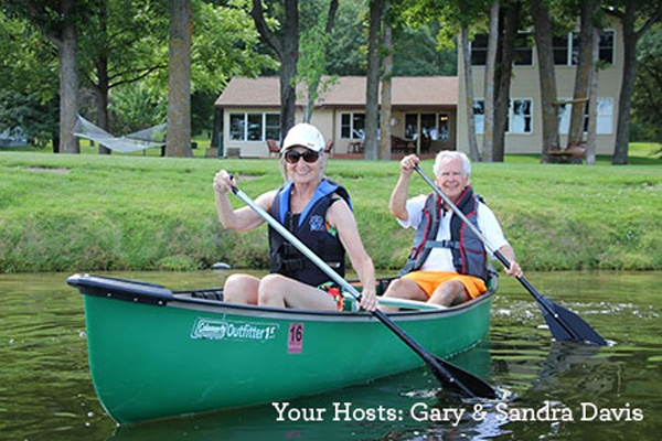 Your hosts, Gary and Sandra Davis, on a canoe ride in front of Leech Lake Resort B&B