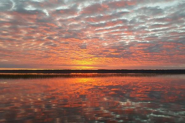 A colorful, pastel sunrise over Leech Lake