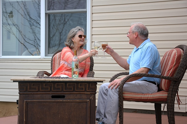 Couple enjoying a romantic glass of wine together on the deck.