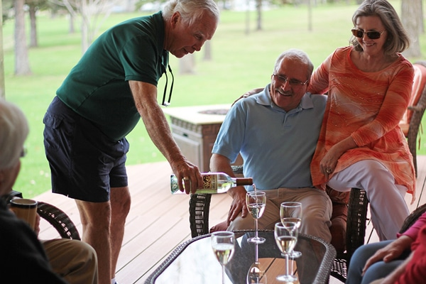 Guests sharing a glass of wine on the front deck.