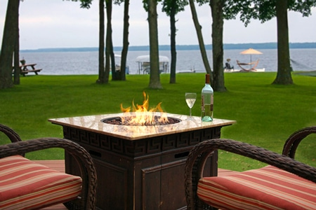 Fire table and chairs on the deck overlooking beautiful Leech Lake