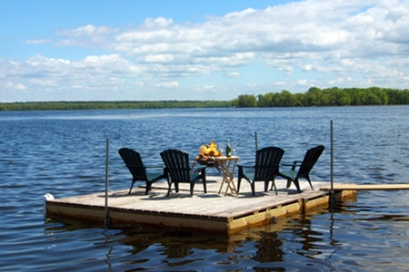 Fire pit and chairs on the floating dock island on Leech Lake.