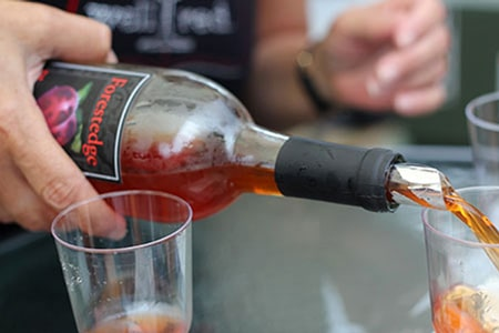 Wine being poured from a bottle at Forest Edge Winery