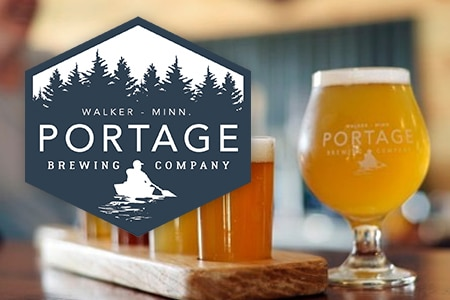 Portage Brewing logo and glass of beer.