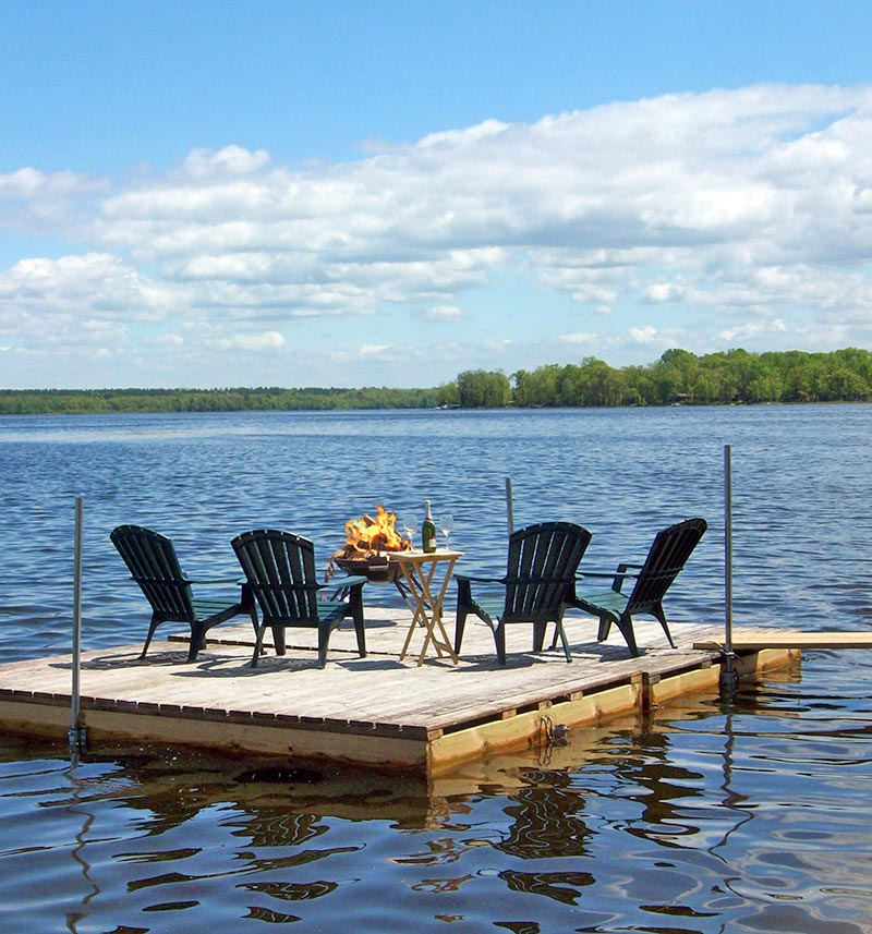 Fire table and four chairs on the floating dock island