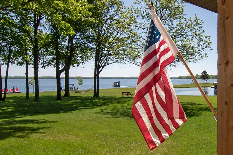 A beautiful sunny day looking across the yard at the lake from the front deck.