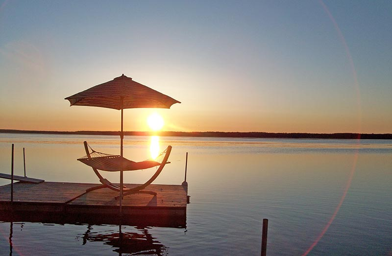 Beautiful sunrise over the lake behind the island hammock