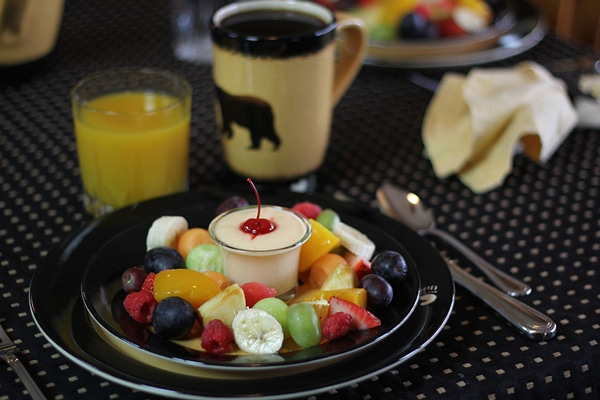Breakfast fruit plate with orange juice and coffee