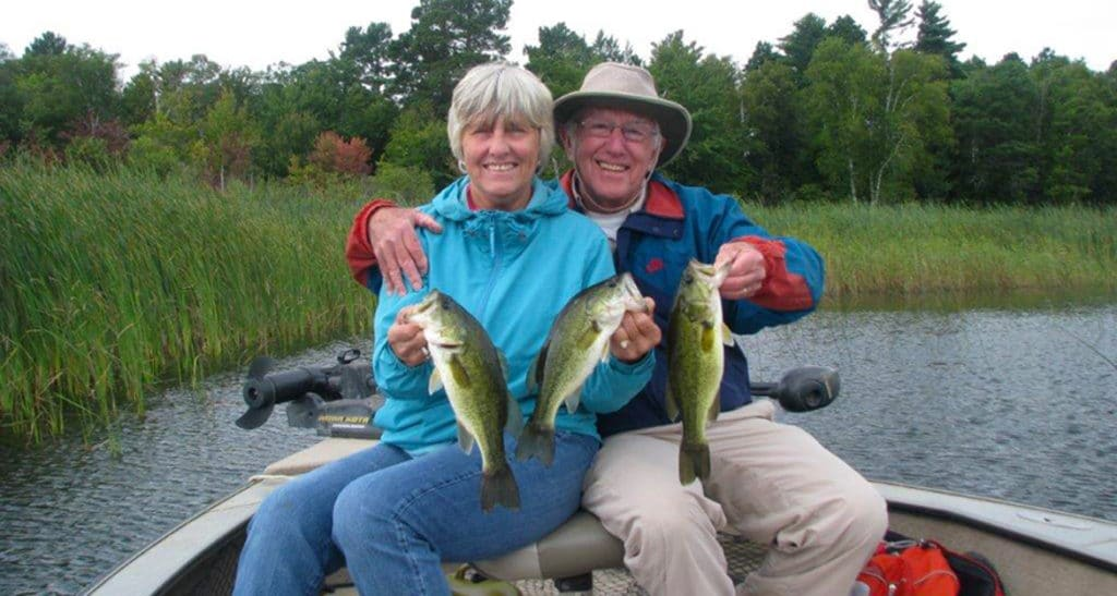 Couple in a boat with the bass they caught on Leech Lake