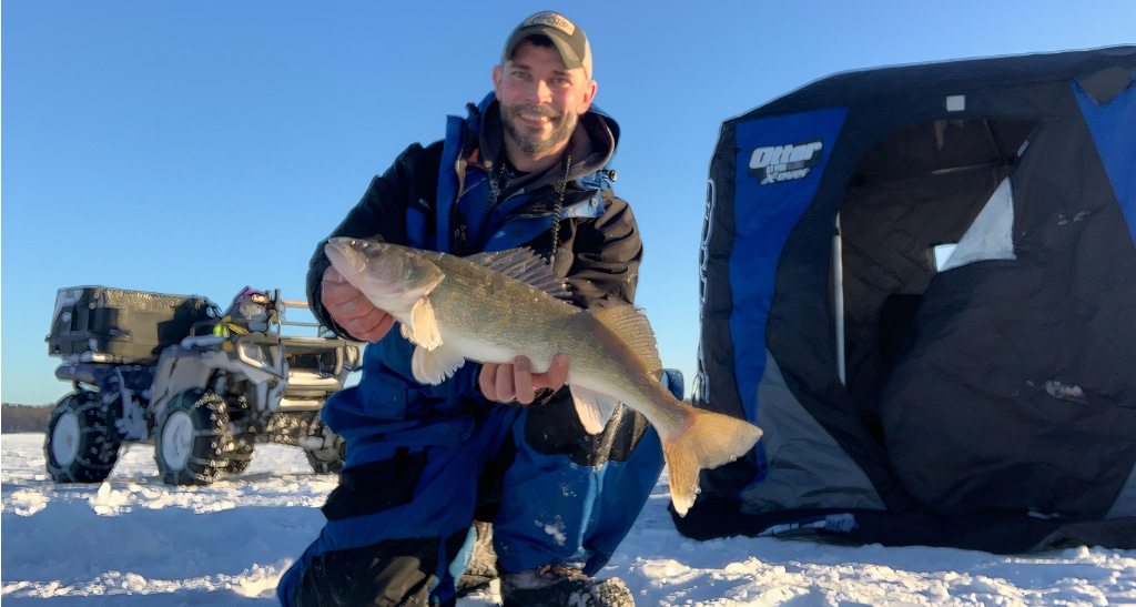A guest with his catch while ice fishing on Leech Lake