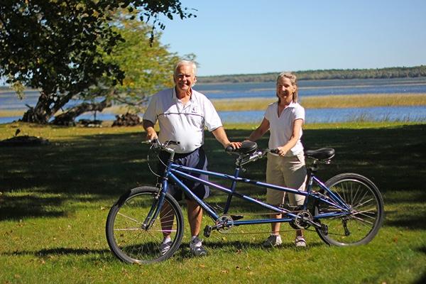 Gary and Sandra Davis with the tandem bicycle at Leech Lake Resort B&B