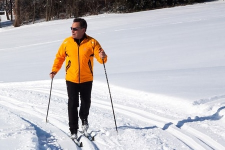 Man cross-country skiing on a sunny winter day