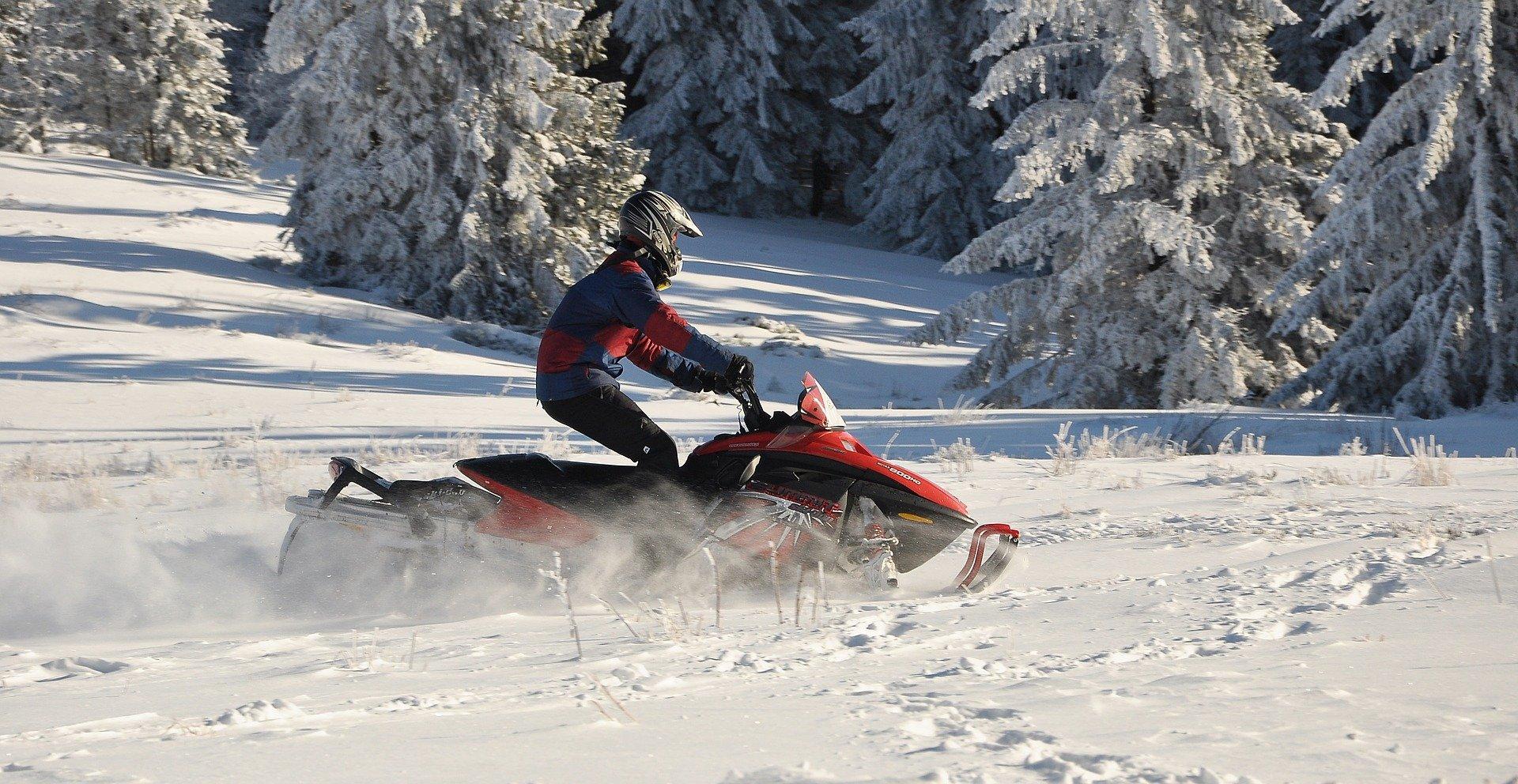 Person riding snowmobile in the winter