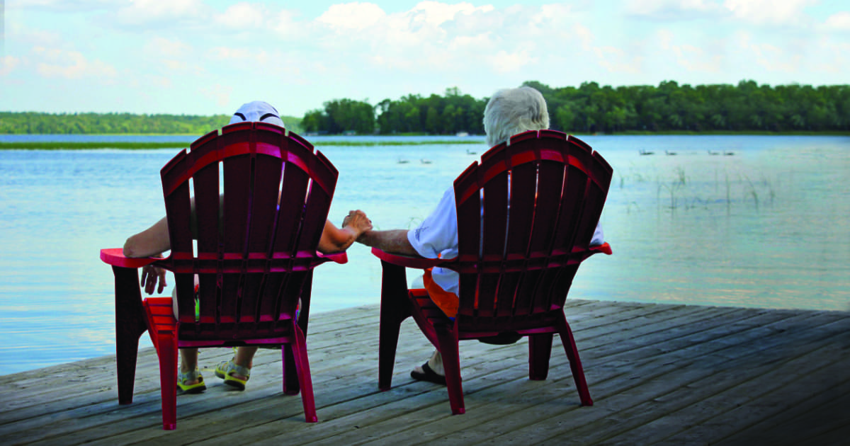 Couple holding hands while enjoying the lake view at Leech Lake Resort B&B in Minnesota