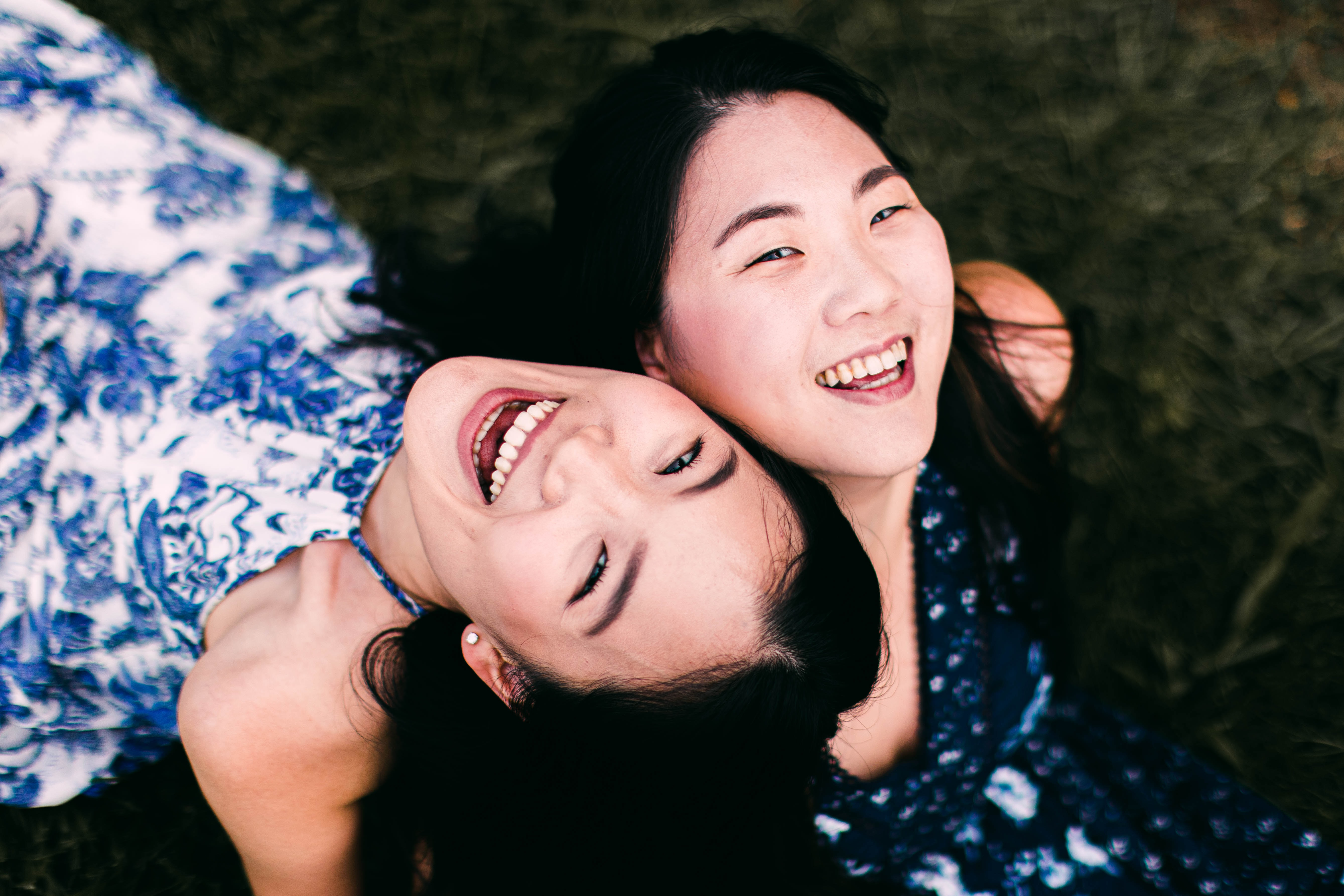 two young girls smiling and laughing
