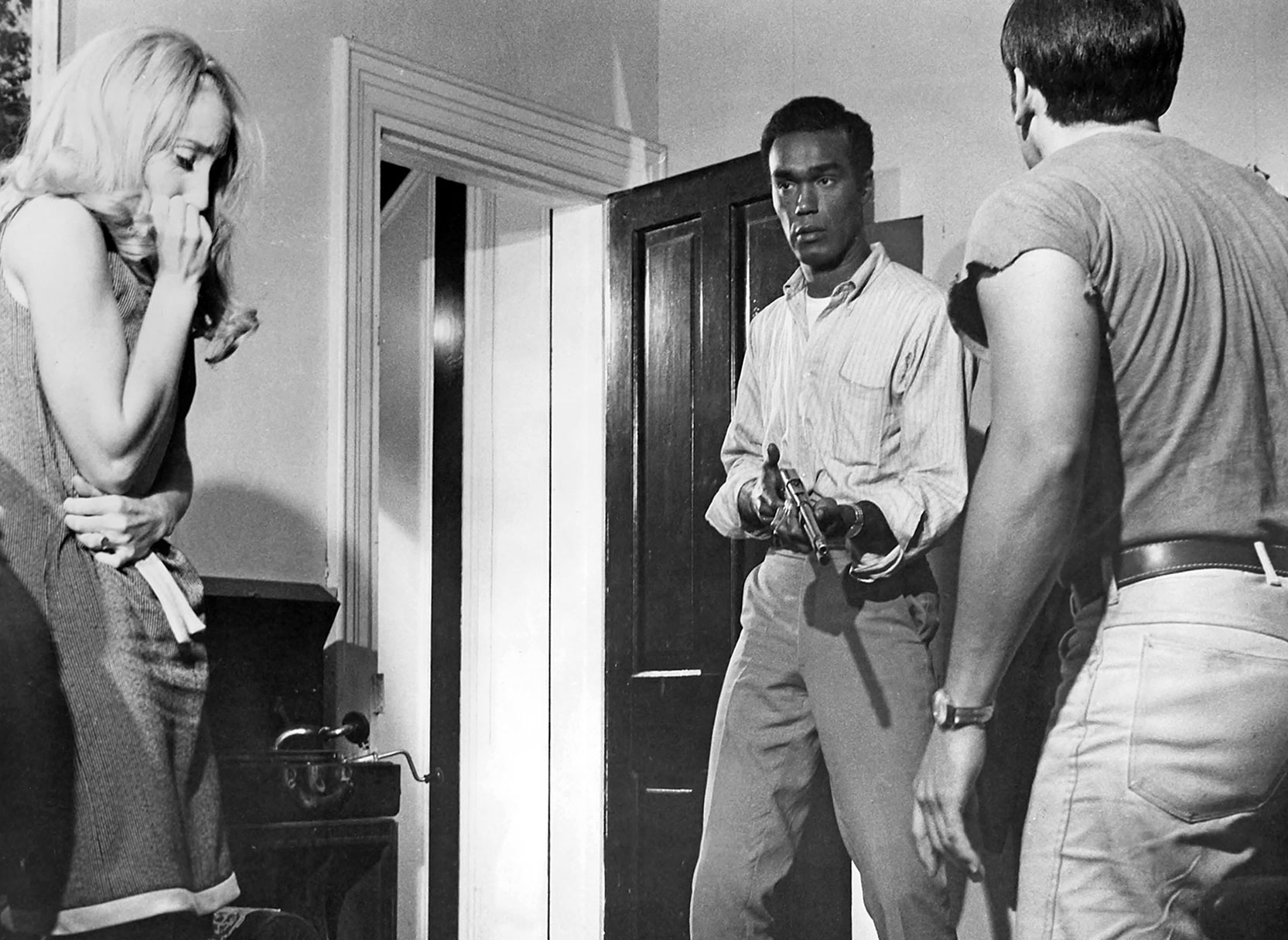 A discussion takes place about the safest location in the farmhouse in a scene from George Romero's Night of the Living Dead (1968).  Photo © Image Ten, Inc. All Rights Reserved