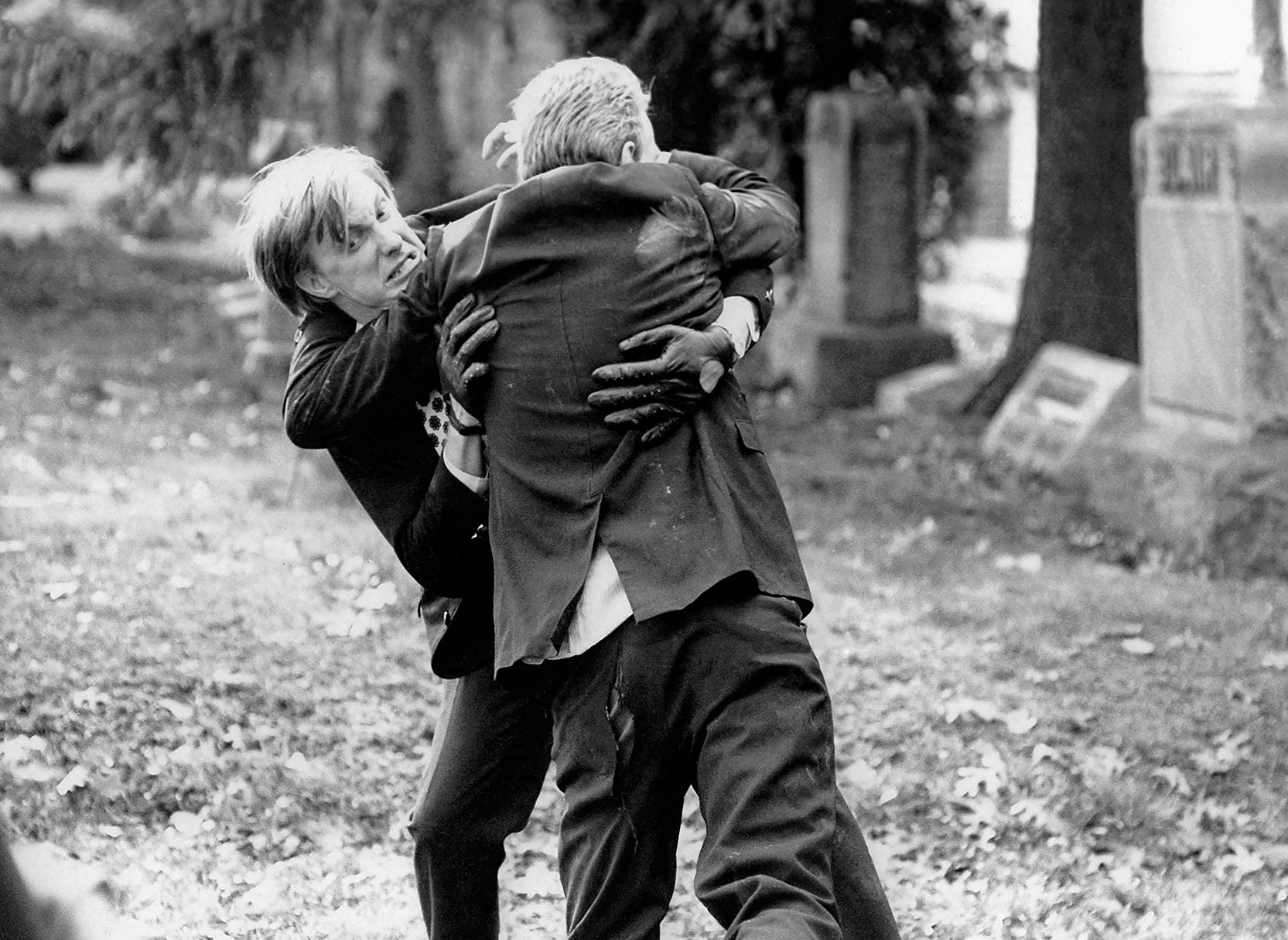Johnny (Russ Streiner) and an undead Ghoul (Bill Hinzman) fight it out in the Evans City Cemetery. A Scene from Night of the Living Dead. Photo © Image Ten, Inc. All Rights Reserved