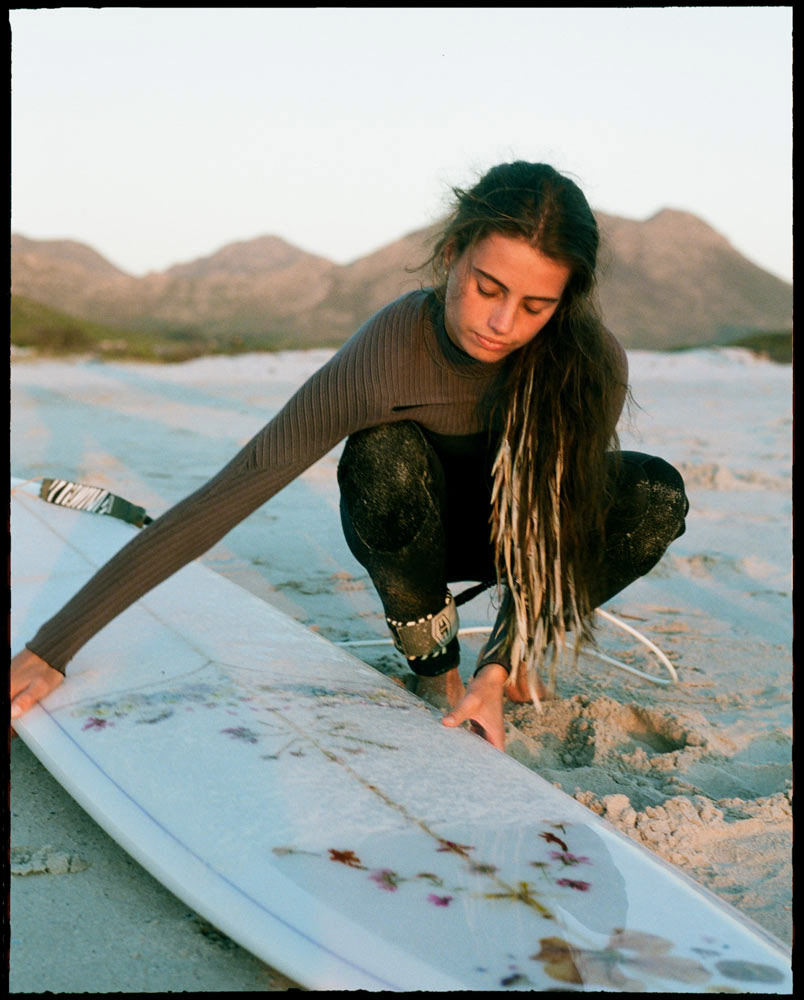 Eden feathers on surfer