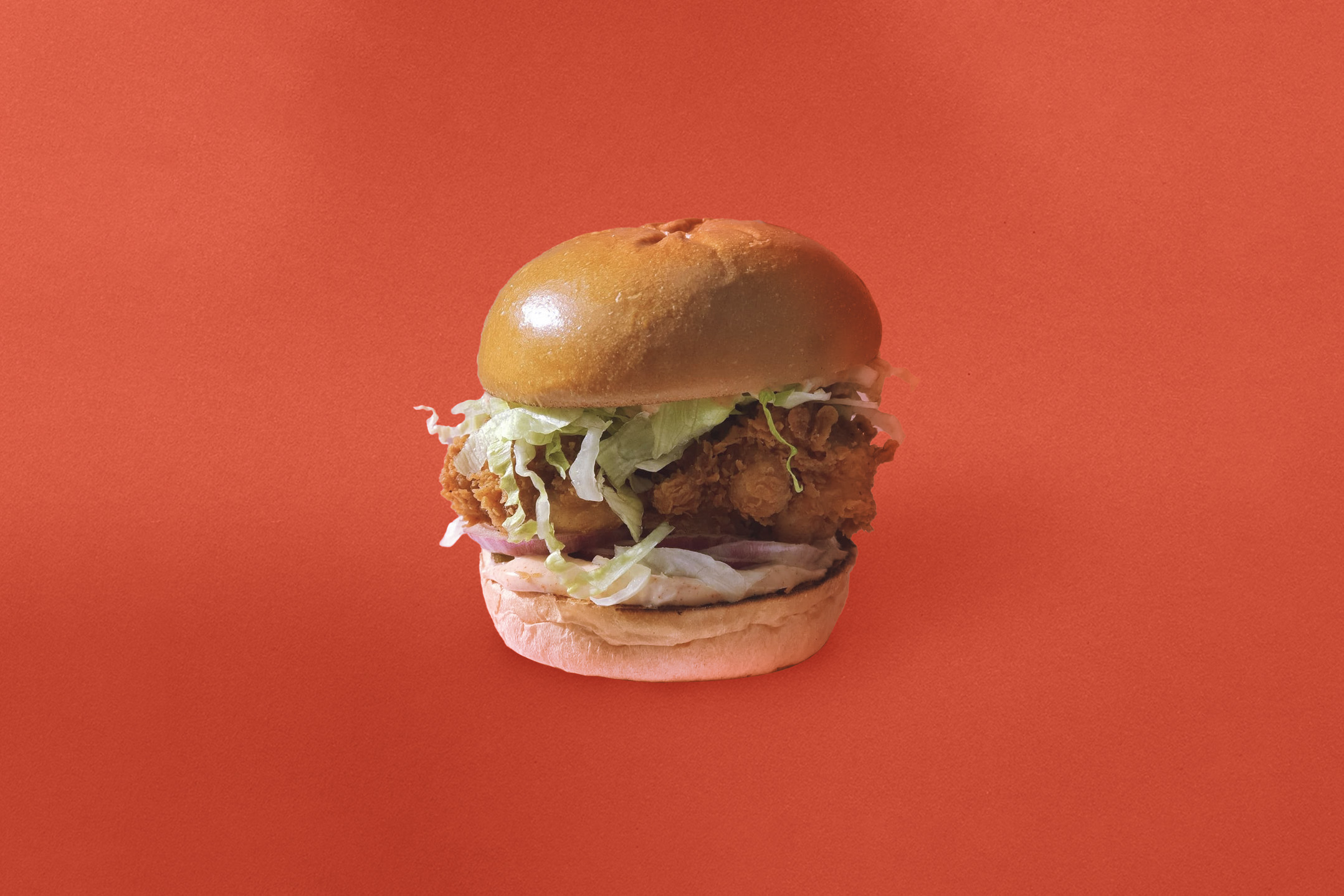 Image of a juicy on the inside crispy on the outside Joels chicken burger