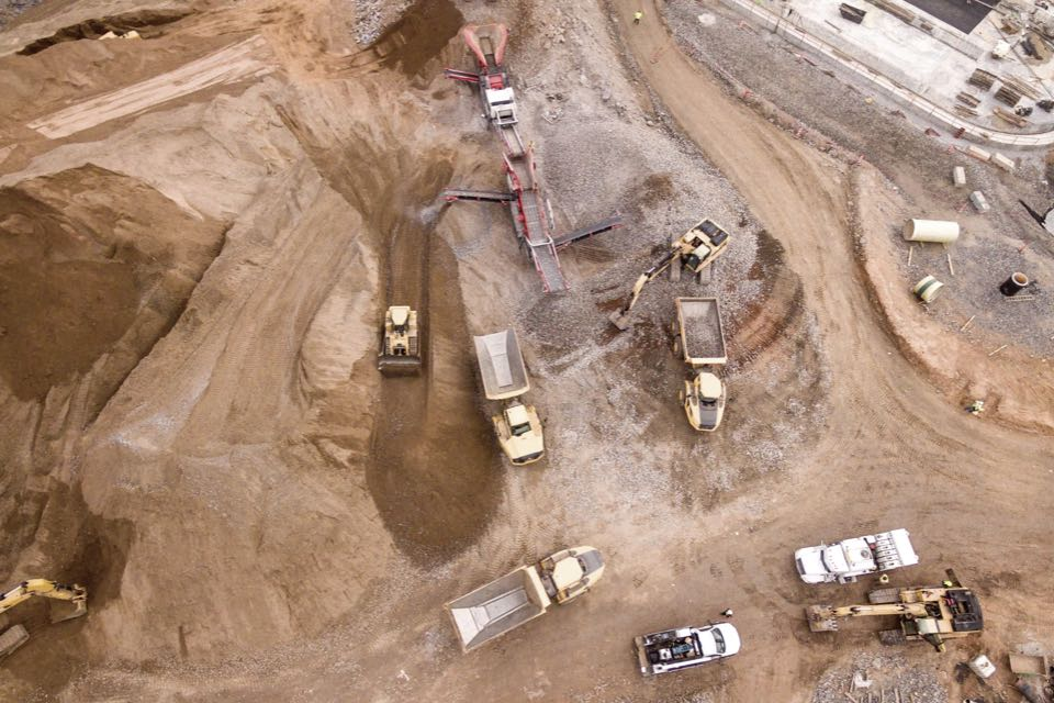Aerial view of large construction site with construction vehicles