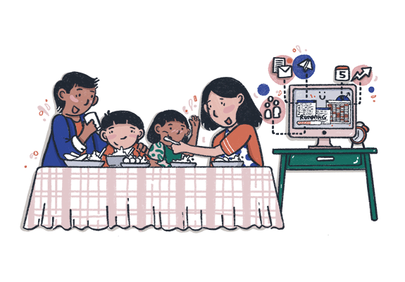 A family eating while a computer is running in the background
