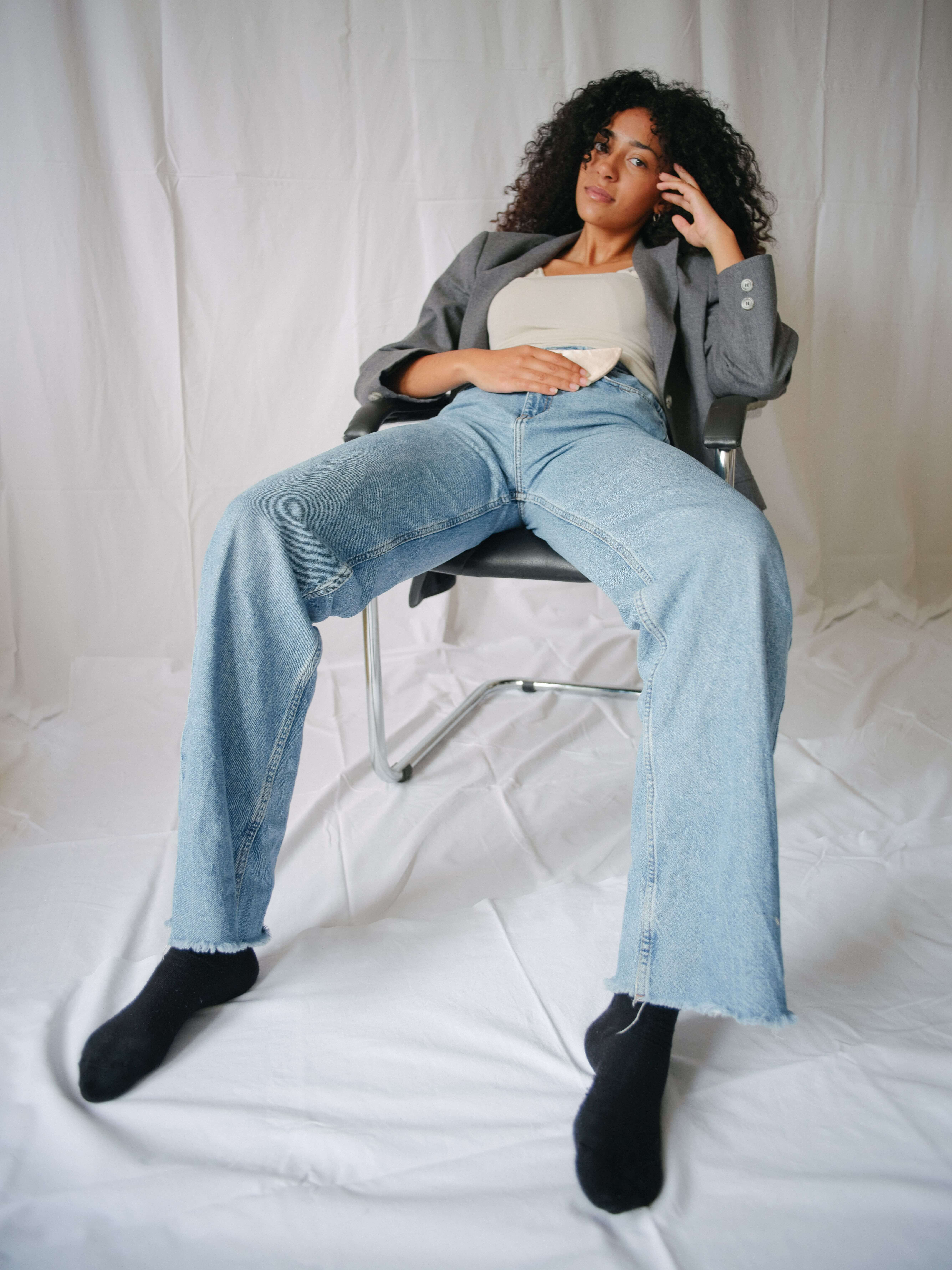a coole pose of a young woman wearing the moon-pad.