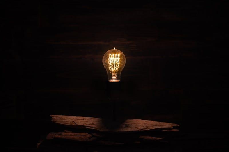 Photo of lightbulb in dark room