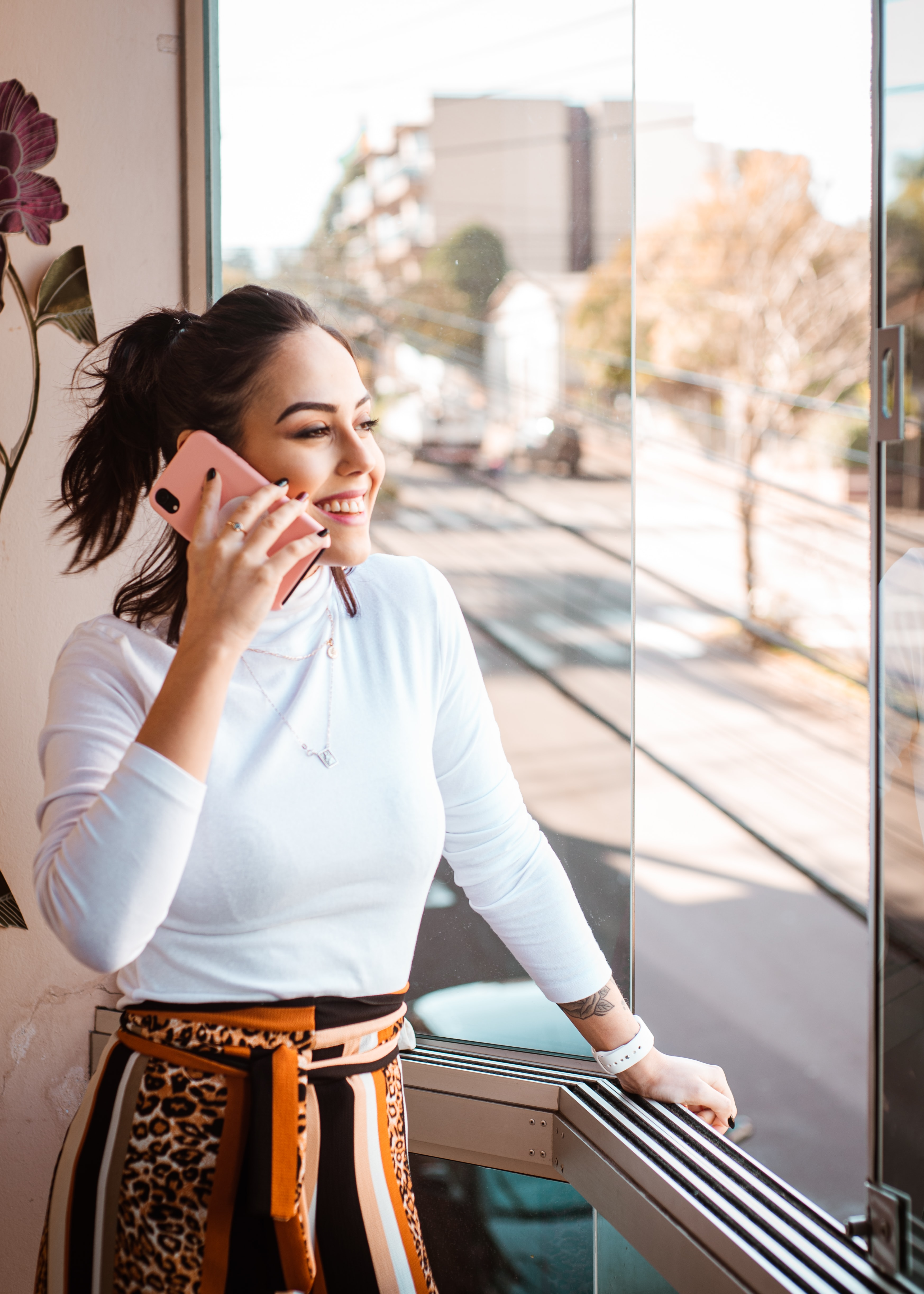 A young lady is on the phone
