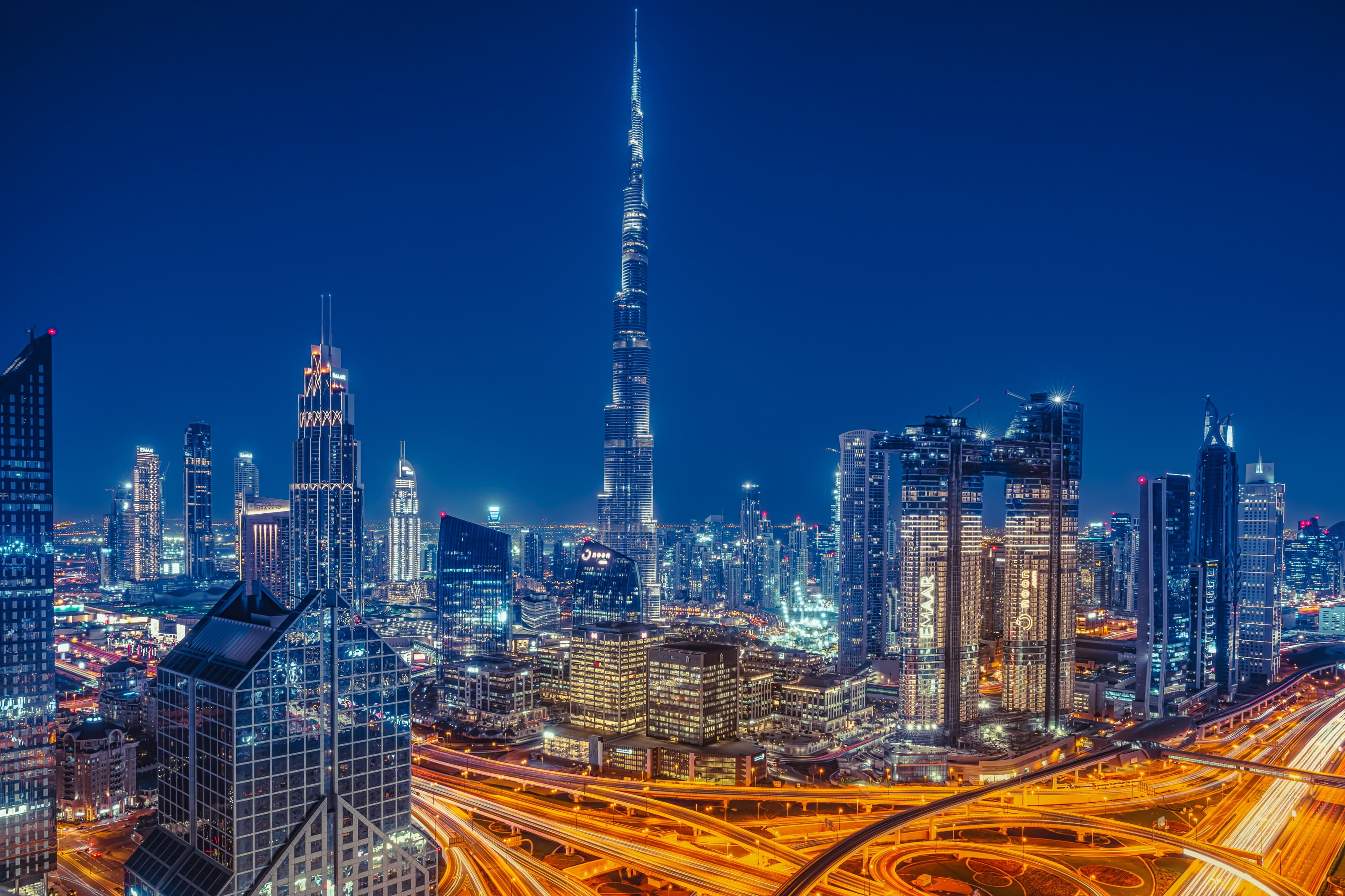 A picture of the Dubai skyline at night. Downtown Dubai and the Burj Khalifa are visible.