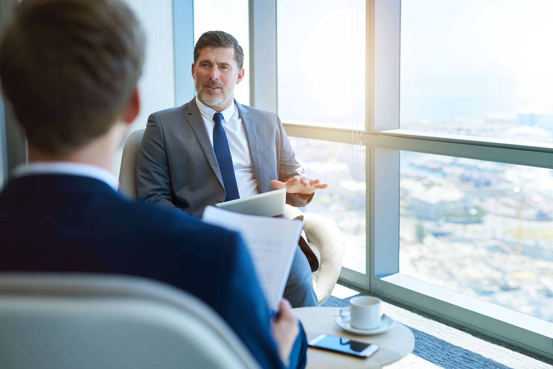 A C level team member is conducting a one-on-one interview for an upper management position in an elite corporate company.