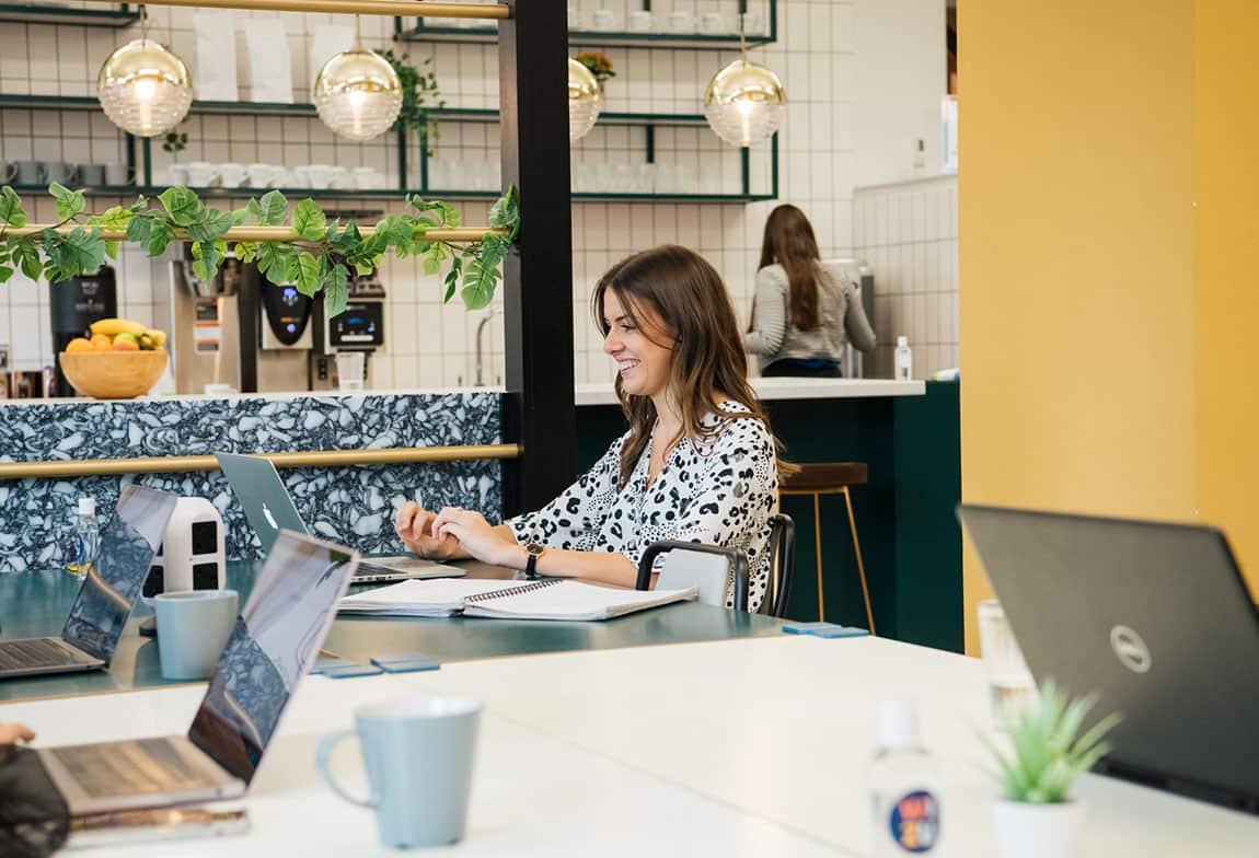 spaces to work wizu workspace co working woman working alone