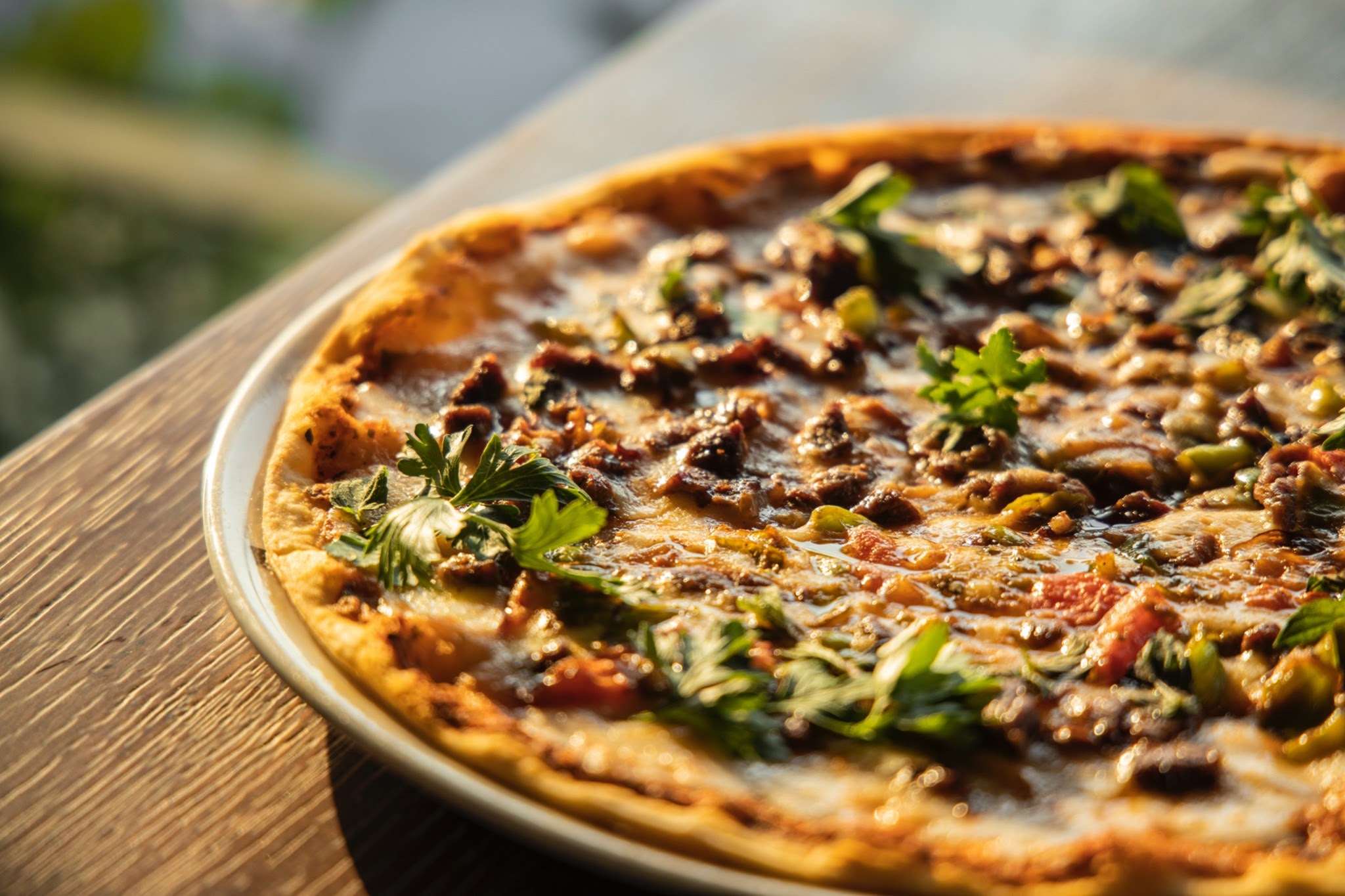 Pizza crust with green toppings