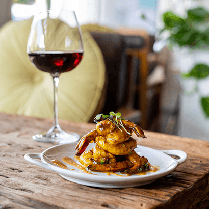 Tamarind prawns with a glass of red wine