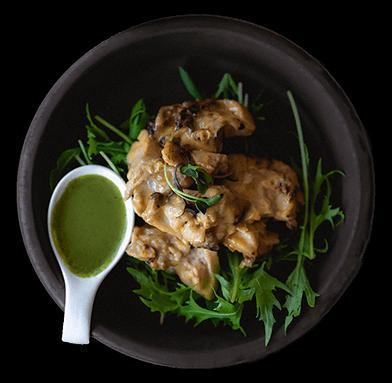 Chicken dish on black plate