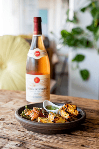 Photo of Paneer dish with bottle of Rose