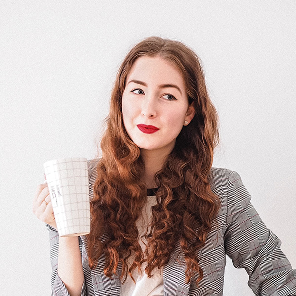 A woman holds a cup of coffee