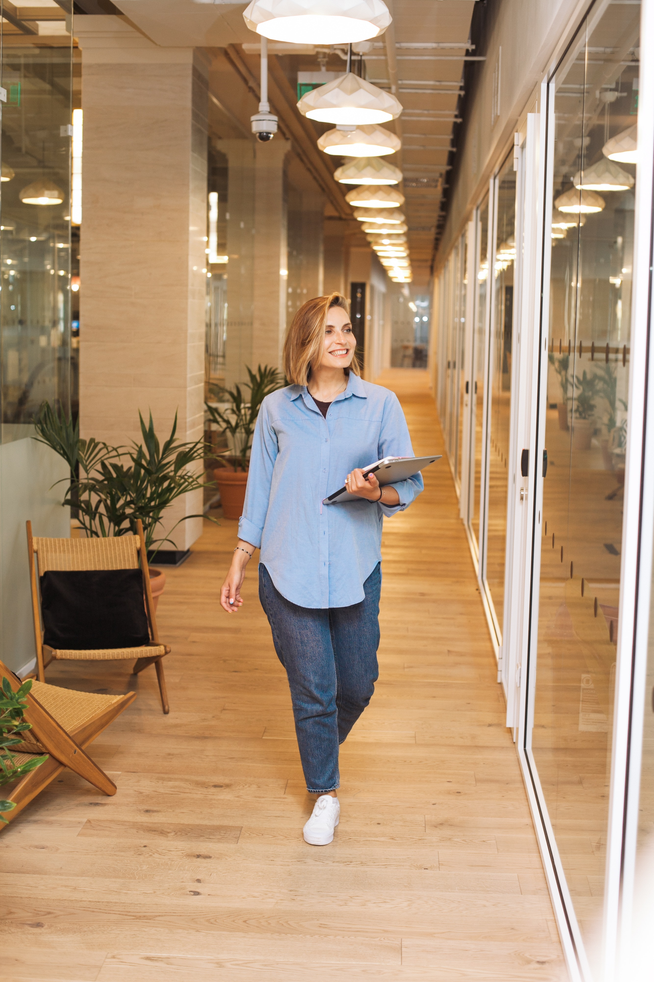 A woman walks through an office