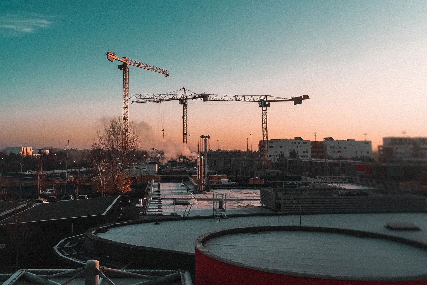 cranes working on a large construction project