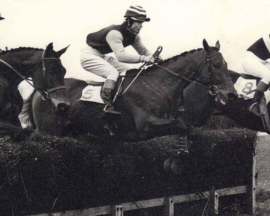 John Bosley riding Rustic Work jumps a fence at the Old Berkshire Hunt race meeting.