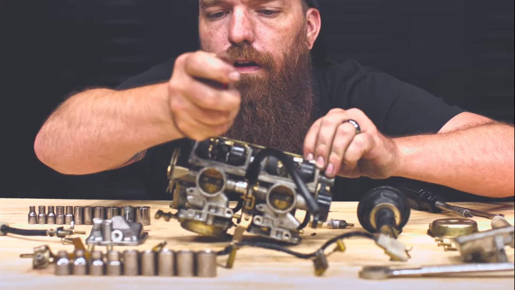 Mathematician, Jeremiah, works on repairing motorcycle parts