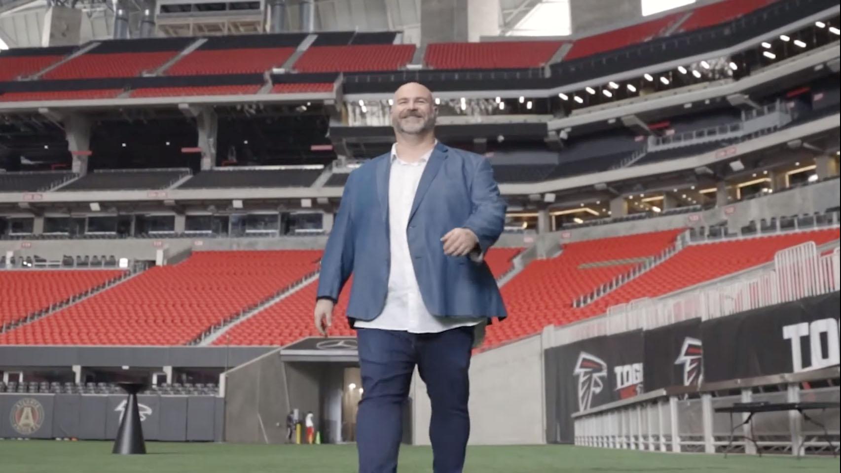 Michael standing in the Atlanta Falcons stadium