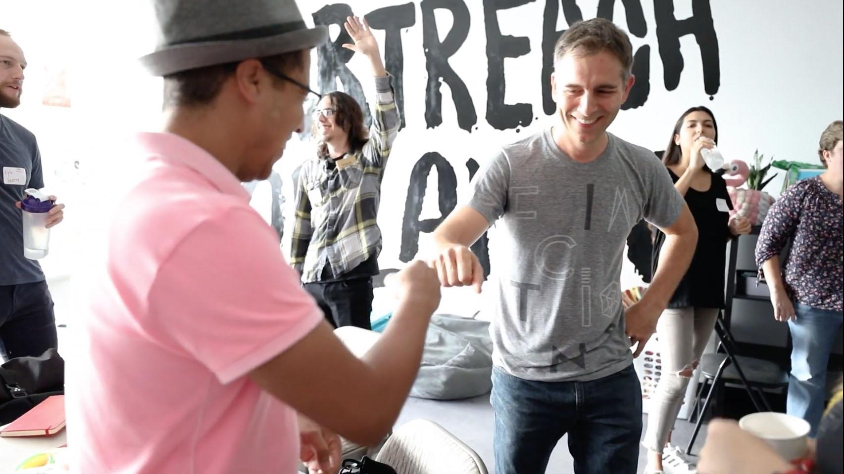 Two workshop participants fist bumping