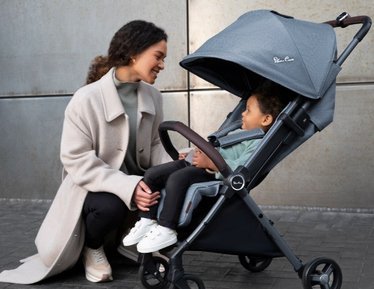 woman with baby in pushchair