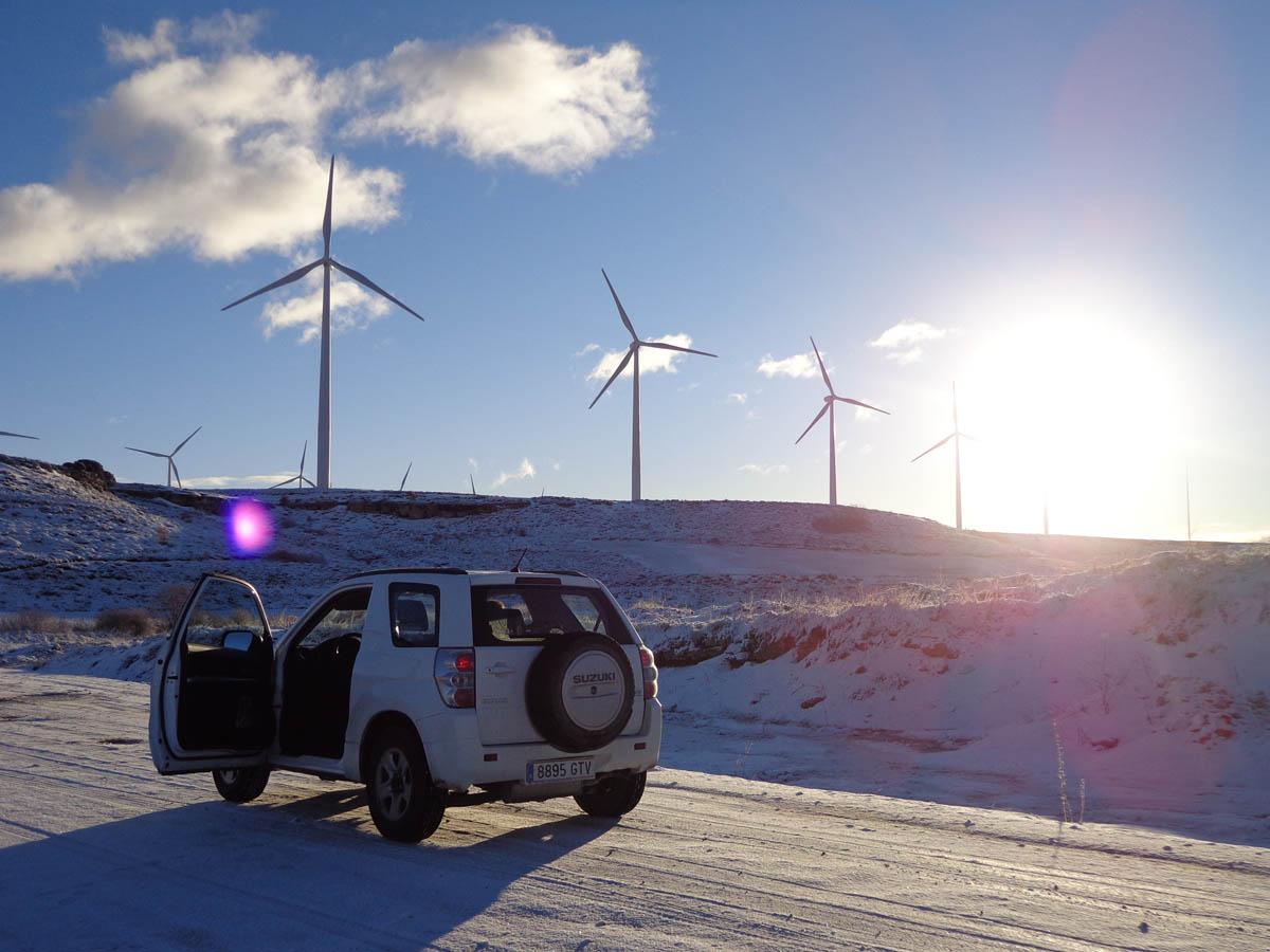 A wind turbine and a car.