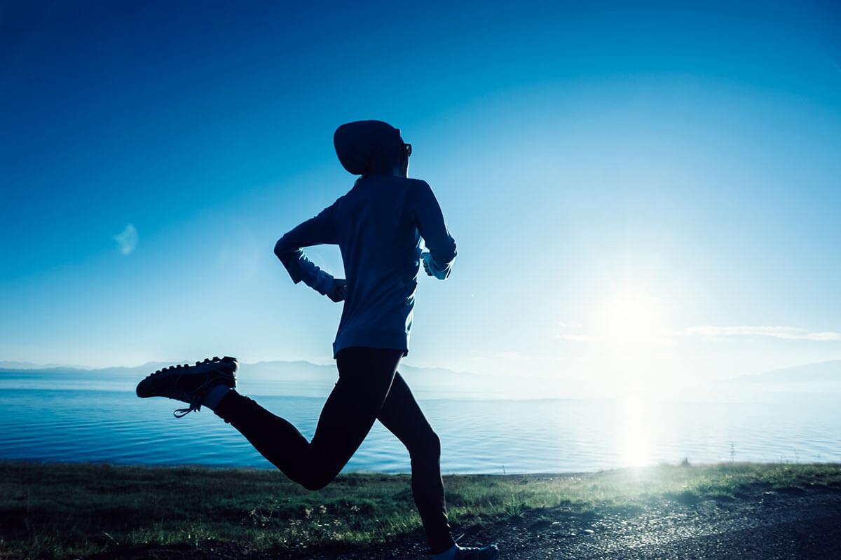A runner on a beach.