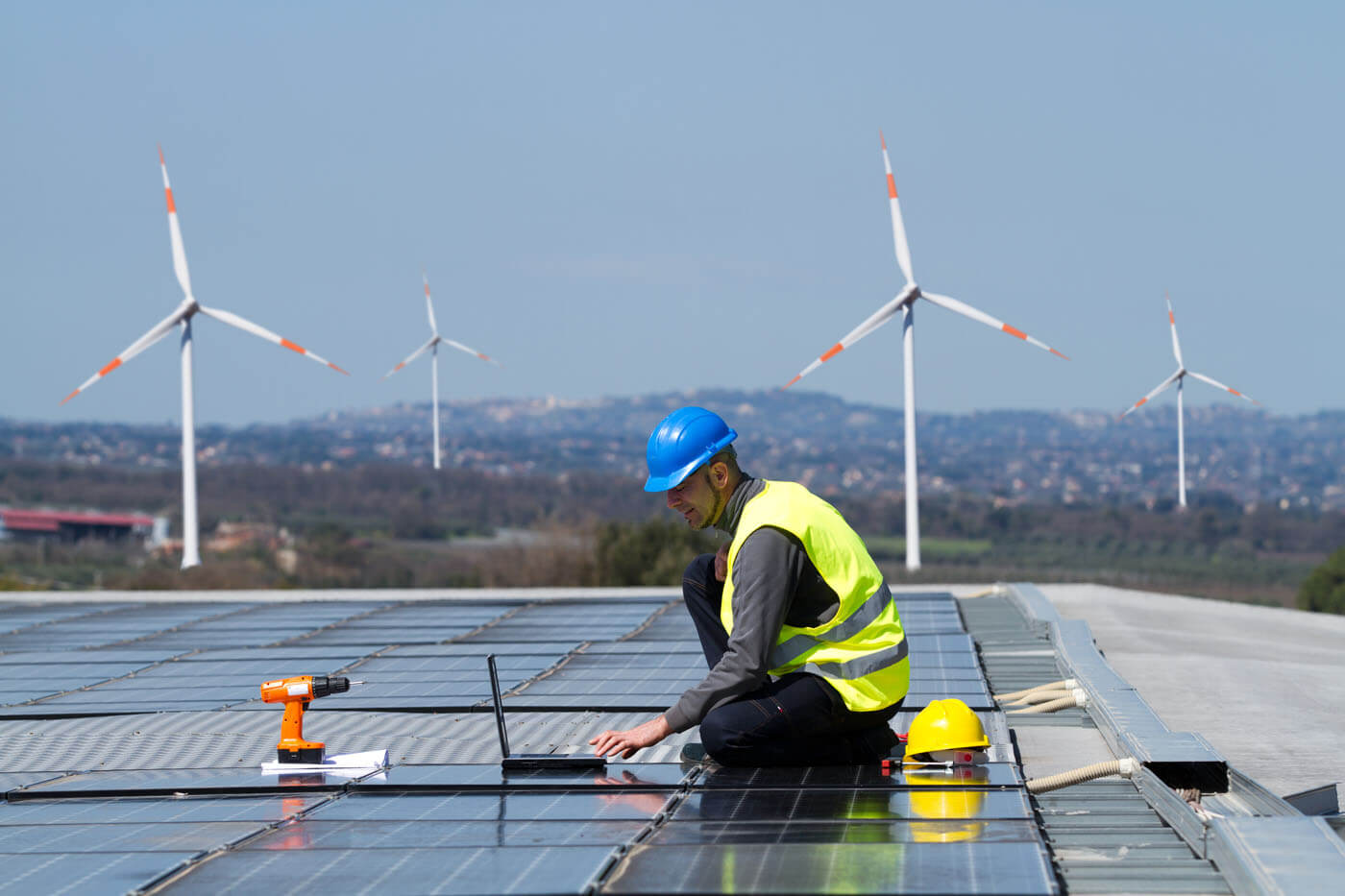 An engineer works on solar panels.