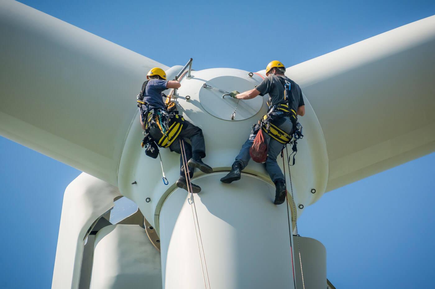 Engineers work on a turbine nacelle.